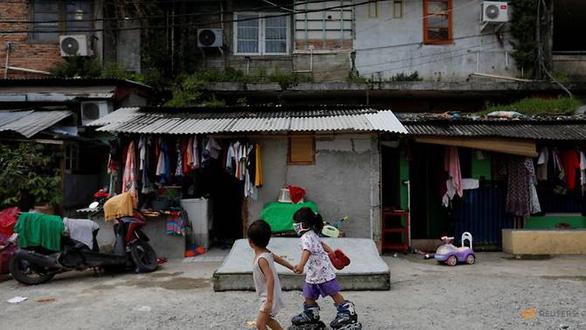 Hàng ngàn trẻ thành mồ côi ở Indonesia vì mất cha mẹ do dịch bệnh - Ảnh 3.