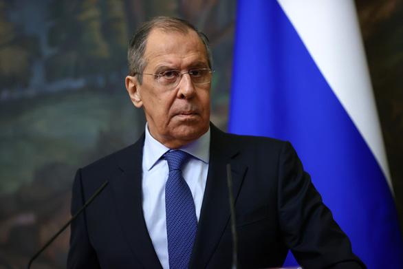 Ngoại trưởng Nga kêu gọi Trung Quốc cùng hạn chế dùng đôla Mỹ - Ảnh 1.