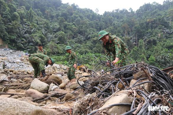 Quân đội, công an tiếp tục tìm kiếm 11 công nhân mất tích tại thủy điện Rào Trăng 3 - Ảnh 3.