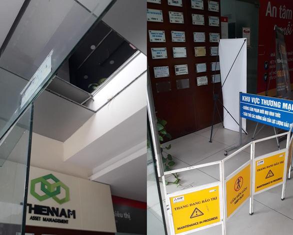 Đang làm việc, hai người rơi từ tầng 2 văn phòng xuống sảnh chung cư - Ảnh 1.