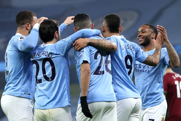 Man City mạnh mẽ san bằng các chướng ngại, thắng trận thứ 21 - Ảnh 1.