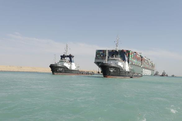 Giao thông kênh đào Suez được khôi phục hoàn toàn sau vụ tàu mắc cạn - Ảnh 1.