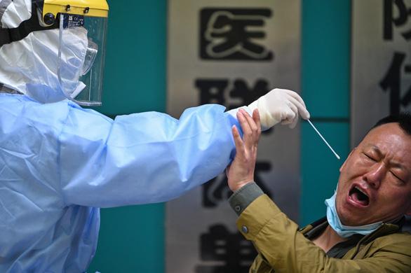 Báo cáo nguồn gốc virus corona: Báo Trung Quốc nói Mỹ không biết gì về khoa học - Ảnh 1.