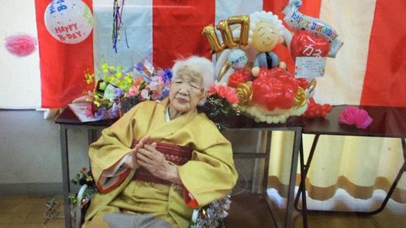 Rước đuốc Olympic Tokyo ở tuổi 118 - Ảnh 1.