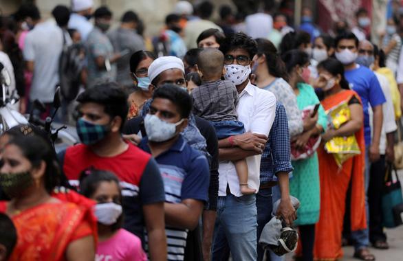 Ca lây nhiễm COVID ở Ấn Độ lại lên 6 số mỗi ngày - Ảnh 3.