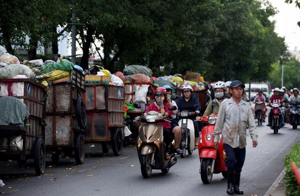 TP.HCM dự kiến thu tiền rác khoảng 50.000 đồng/tháng - Ảnh 1.