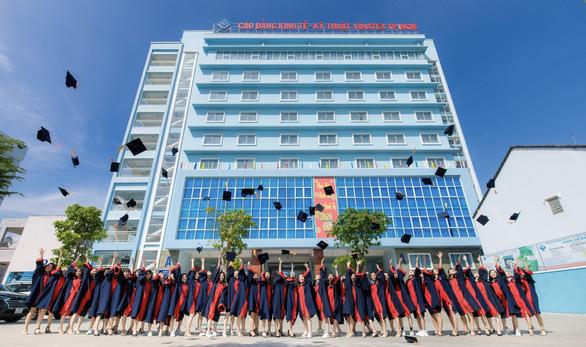 Trường cao đẳng Kinh tế kỹ thuật Vinatex TP.HCM đổi tên lần thứ 5 - Ảnh 1.