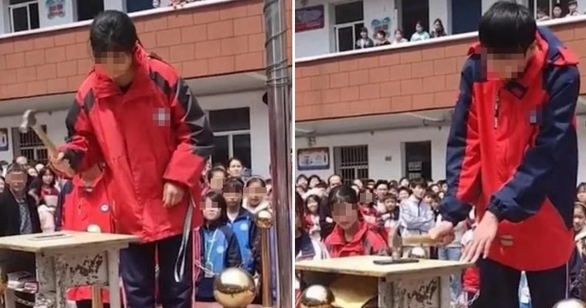 Trường học ở Trung Quốc bắt học sinh đập điện thoại để tập trung thi cử - Ảnh 1.