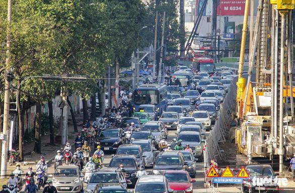 Khẩn trương thi công đưa đường Nguyễn Hữu Cảnh kịp cán đích dịp 30-4 - Ảnh 2.
