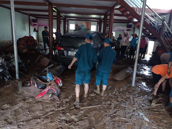 Thủ tướng yêu cầu khẩn trương khắc phục hậu quả mưa lũ làm 3 người chết ở Lào Cai - Ảnh 1.
