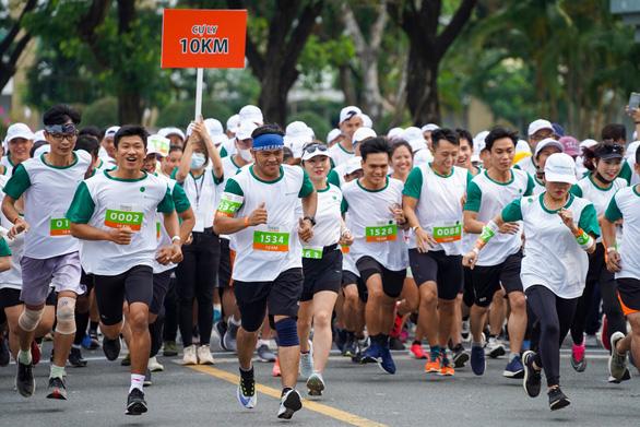 Nutrilite lan tỏa thông điệp sức khỏe ý nghĩa trong ngày hội chạy bộ - Ảnh 1.