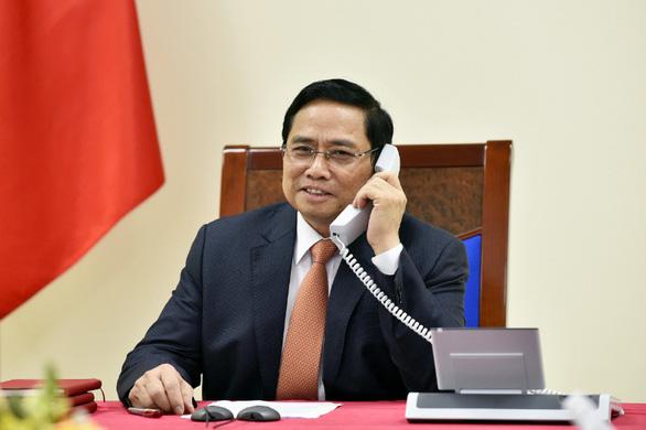 Thủ tướng Phạm Minh Chính mời Thủ tướng Singapore Lý Hiển Long thăm Việt Nam - Ảnh 1.