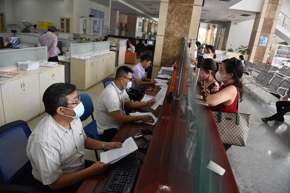 TP.HCM thu thuế thu nhập doanh nghiệp quý 1 tăng 6.136 tỉ đồng, cao nhất 5 năm - Ảnh 1.