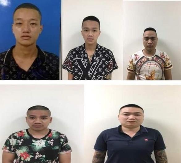 Bắt nhóm tín dụng đen cho vay lãi cao cắt cổ hơn 200% ở Hà Nội - Ảnh 1.