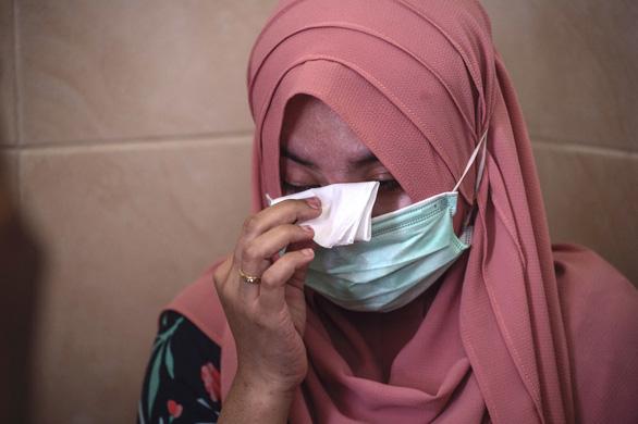 Thủy thủ tàu ngầm Indonesia dặn vợ và con gái cầu nguyện trước khi mất tích - Ảnh 1.