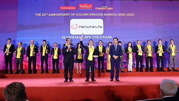 Hanwha Life Việt Nam vinh dự nhận giải thưởng Rồng Vàng 2021 - Ảnh 1.