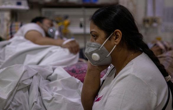 Ấn Độ thêm 386.452 ca dương tính, 3.498 người chết - Ảnh 1.