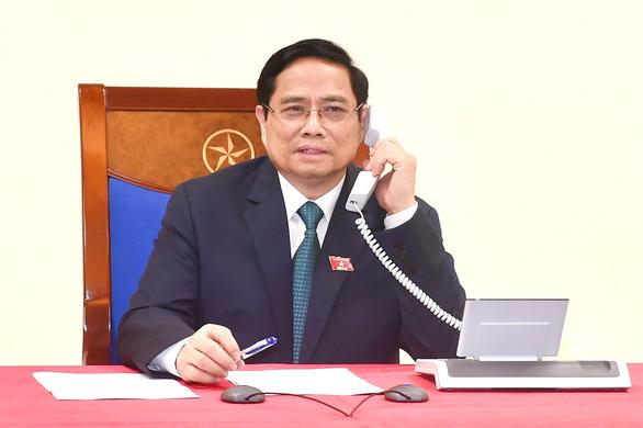 Việt Nam hỗ trợ Lào 500.000 USD ứng phó COVID-19 - Ảnh 1.