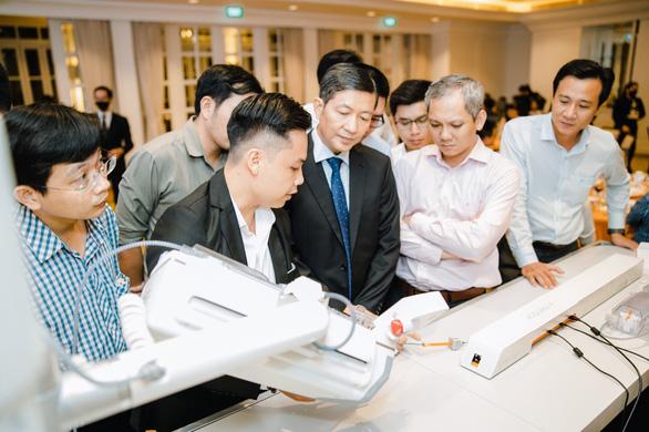 Hội thảo ra mắt hệ thống robot can thiệp mạch máu tại Việt Nam - Ảnh 2.