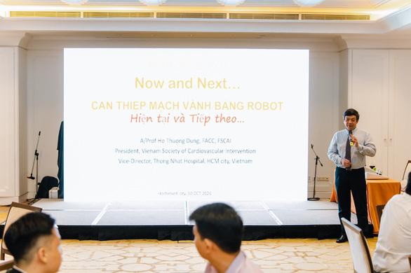 Hội thảo ra mắt hệ thống robot can thiệp mạch máu tại Việt Nam - Ảnh 3.