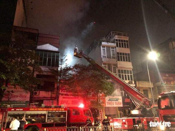 Cháy cửa hàng đồ sơ sinh ở Hà Nội: 4 người thiệt mạng - Ảnh 1.