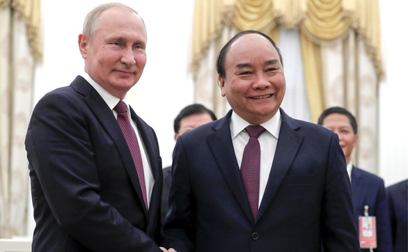 Ông Putin, ông Tập chúc mừng tân Chủ tịch nước Nguyễn Xuân Phúc - Ảnh 1.