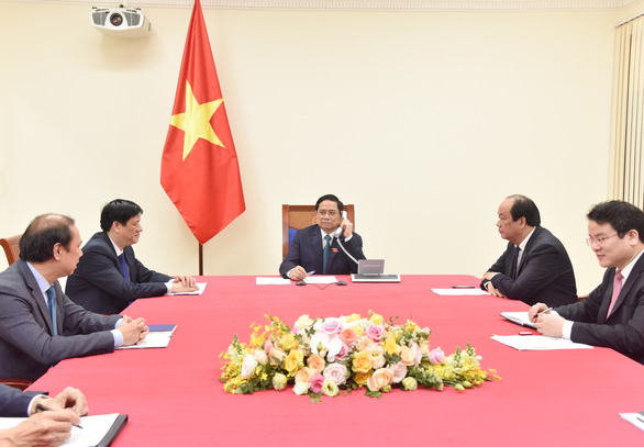 Prime Minister Pham Minh Chinh telephones with Prime Minister of Laos and Cambodia - Photo 2.