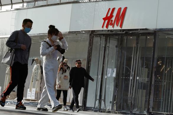 H&M và các công ty đa quốc gia tiến thoái lưỡng nan vì Tân Cương - Ảnh 3.