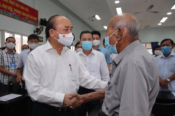 Chủ tịch nước Nguyễn Xuân Phúc: Hóc Môn không chỉ là huyện, phải là quận đô thị sinh thái - Ảnh 1.