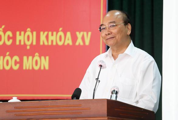 Chủ tịch nước Nguyễn Xuân Phúc: Hóc Môn không chỉ là huyện, phải là quận đô thị sinh thái - Ảnh 2.