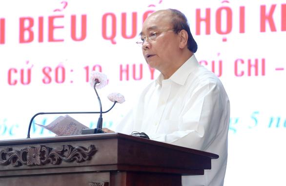 Chủ tịch nước Nguyễn Xuân Phúc: Không thể làm chính sách trong phòng lạnh - Ảnh 2.