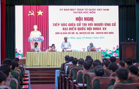 Chủ tịch nước Nguyễn Xuân Phúc: Không thể làm chính sách trong phòng lạnh - Ảnh 3.