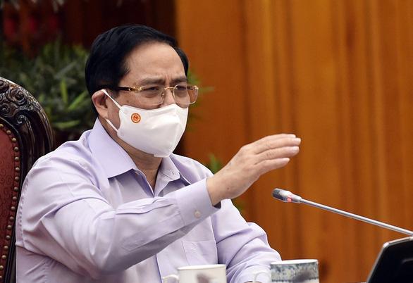 Thủ tướng Phạm Minh Chính nhấn mạnh yêu cầu kiểm điểm trách nhiệm khi không thực hiện nghiêm việc phòng, chống dịch - Ảnh: VGP