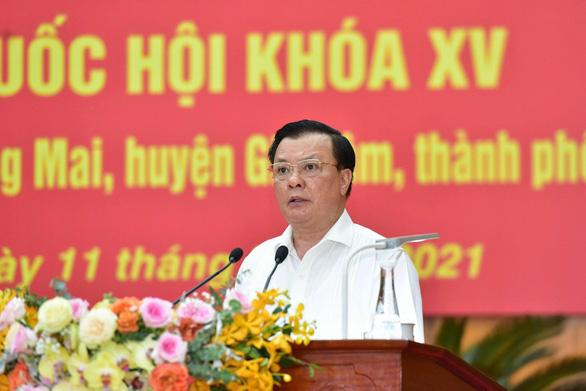 Bí thư Hà Nội Đinh Tiến Dũng hứa gương mẫu và gắn bó mật thiết với cử tri - Ảnh 1.