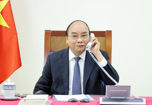 Chủ tịch nước Nguyễn Xuân Phúc nhắc lại lời mời Tổng thống Pháp Macron thăm Việt Nam - Ảnh 1.
