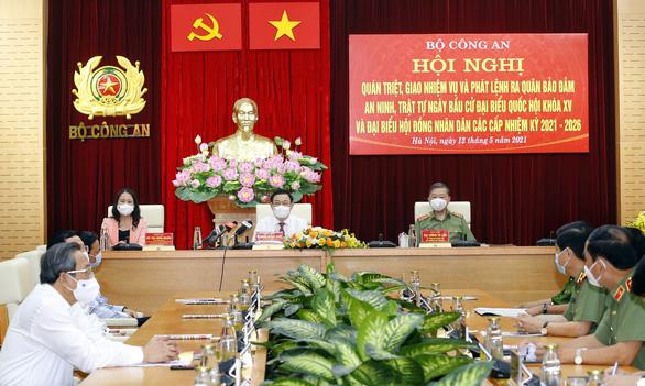 Bộ trưởng Tô Lâm: Công an sẵn sàng bảo vệ tuyệt đối an ninh, an toàn ngày bầu cử - Ảnh 1.