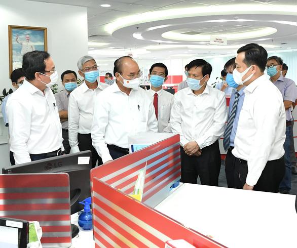 Chủ tịch nước Nguyễn Xuân Phúc thăm báo Sài Gòn Giải Phóng - Ảnh 1.