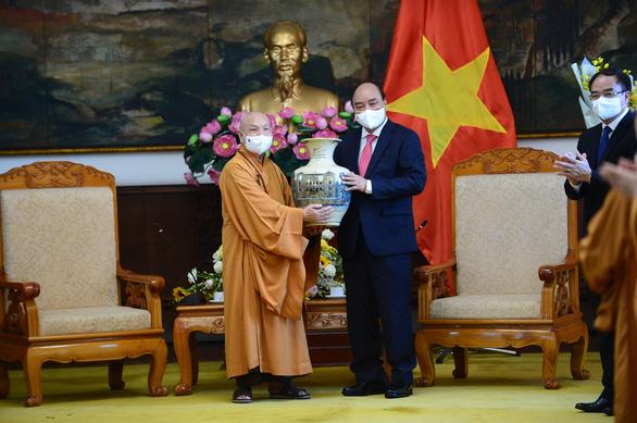 Chủ tịch nước Nguyễn Xuân Phúc: Phát huy các nguồn lực tôn giáo cho sự phát triển Việt Nam - Ảnh 2.