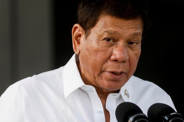 Ông Duterte nói không lùi bước ở Biển Đông dù chết dưới tay Trung Quốc - Ảnh 1.