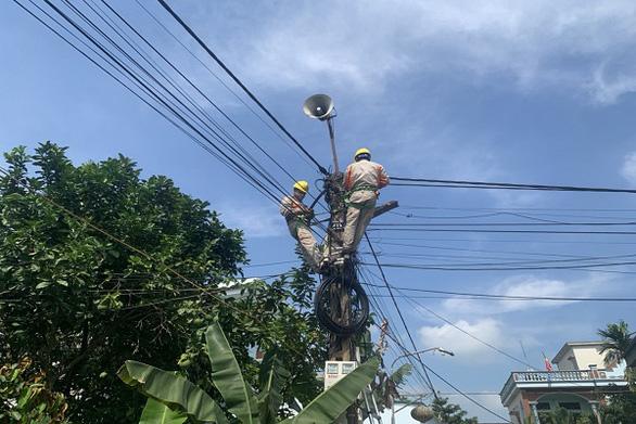EVNNPC: Đảm bảo cấp điện mùa nắng nóng và chống dịch COVID-19 - Ảnh 1.