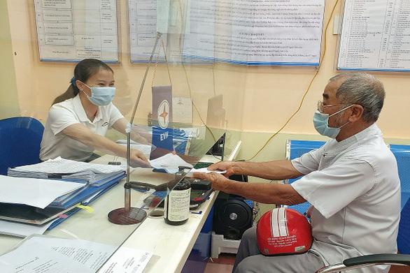 EVNNPC: Đảm bảo cấp điện mùa nắng nóng và chống dịch COVID-19 - Ảnh 2.