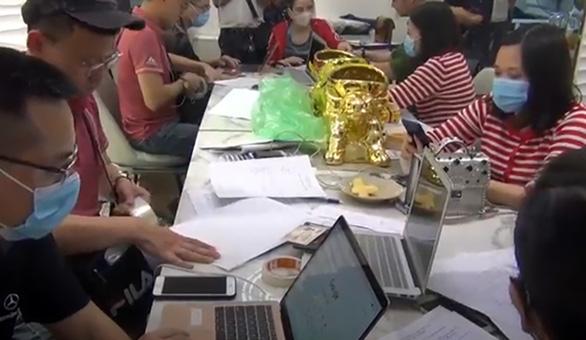 Công an Hà Nội và TP.HCM cùng triệt phá 4 sàn giao dịch vàng, tiền ảo - Ảnh 1.