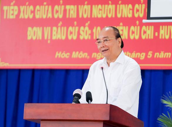 Chủ tịch nước Nguyễn Xuân Phúc: Giao thông kết nối mạnh thì Củ Chi, Hóc Môn là đất vàng - Ảnh 2.