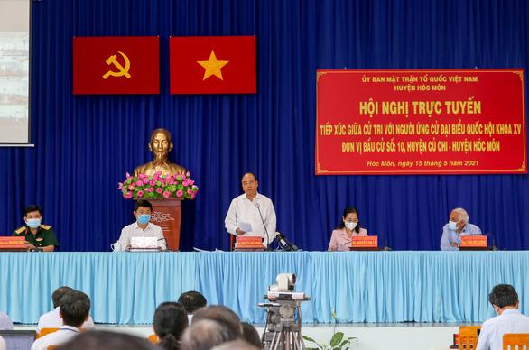 Chủ tịch nước Nguyễn Xuân Phúc: Giao thông kết nối mạnh thì Củ Chi, Hóc Môn là đất vàng - Ảnh 1.