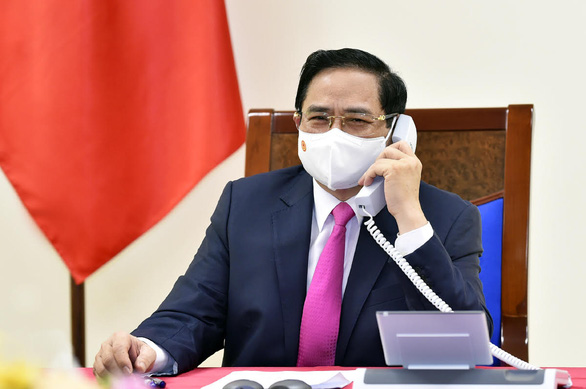 Nhật hứa hỗ trợ Việt Nam bảo đảm vắc xin ngừa COVID-19 cần thiết - Ảnh 1.