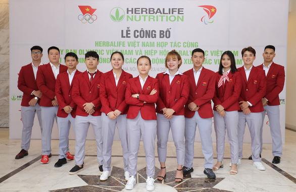 Herbalife Việt Nam tài trợ sản phẩm dinh dưỡng cho các vận động viên Việt Nam xuất sắc - Ảnh 2.