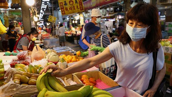 Kinh tế sáng sủa dần nhưng lại lo virus lạm phát - Ảnh 1.
