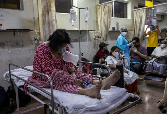 Ấn Độ thêm 392.000 ca COVID-19 trong ngày, lập kỷ lục mới về số người chết - Ảnh 1.