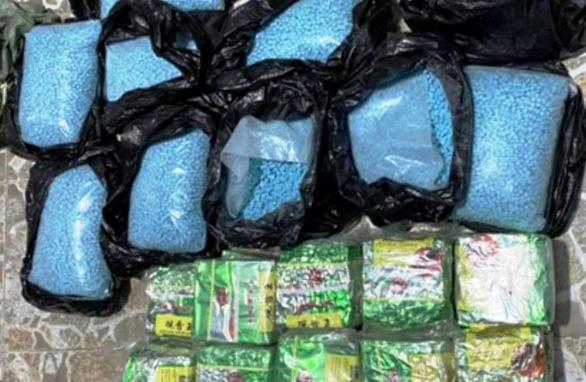 Phá đường dây ma túy lớn, thu hơn 30 bánh heroin, hàng chục ngàn viên thuốc lắc - Ảnh 1.
