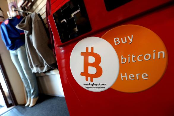 Giá trị đồng tiền ảo bitcoin sáng giảm sâu, chiều tăng mạnh - Ảnh 1.